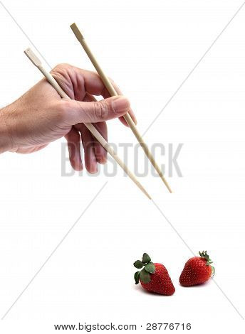 chopsticks and strawberries