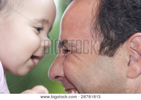 Beautiful Little Girl Playing With Dad
