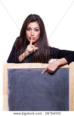 Keep It Secret. Woman Pointing At A Blank Blackboard