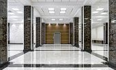 Marble Interior Of A Luxury Lobby Of Company Or Hotel. Clean Corporate Hallway With Real Floor Tile. poster