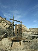 pic of chute  - A weathered corral with loading chute in a rocky canyon - JPG
