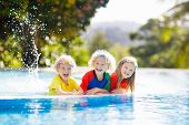 Kids In Swimming Pool. Children Swim. Family Fun. poster