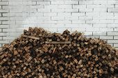 Preparation Of Firewood For The Winter. Firewood Background, Stacks Of Firewood In The Forest poster