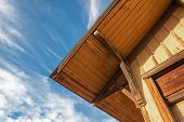 Old Building With Exterior Corner Roof Detail, Blue Sky, Construction Detail, Horizontal Aspect poster