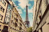 Eiffel Tower seen from the street of Paris, France. Summertime. Popular travel destination. poster