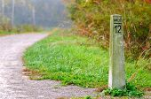 image of mile  - Stone mile marker on a hiking - JPG