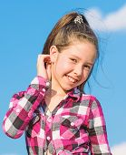 Kids Fashion Concept. Kid Girl Checkered Fashionable Shirt Posing Sunny Day Blue Sky Background. Chi poster