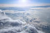 Heavenly Landscape With Shining Sun. Big White Clouds On Blue Sky. Beautiful White Clouds On Blue Sk poster