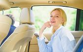 Business Life Concept. Business Woman Sit On Backseat. Busy Lady Passenger Leather Car Salon Enjoy J poster