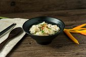 Shrimp Wonton With Braised Pork In Soup On Wooden Table - Asian Food Style  / Select Focus Image poster