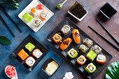 Traditional Japanese Food- Sushi, Rolls, Chopsticks, Soy Sauce On Color Stone Background. Sushi Menu poster