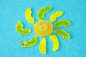 The Sun From Yellow Marmalade With Rays On A Light Blue Background Of Felt. Sugar Sweet Christmas Sw poster