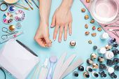 Beautifully Manicured Nails On The Desktop With Tools For Manicure. Care About The Nails poster