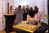 Delicious Snacks On Catering Table During Corporate Event Party - Brunch Choice Of Food With Blurred poster