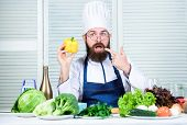 Man Wear Apron Cooking In Kitchen. Man Cooking Healthy Recipe Pepper Vegetable. Cooking As Hobby And poster