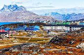 Inuit Houses And Cottages Scattered Across Tundra Landscape In Residential Suburb Of Nuuk City With  poster