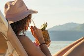Traveler Girl Relaxing On The Beach. Young Girl Traveler Relaxing In Vacation. Traveler Relaxing On  poster