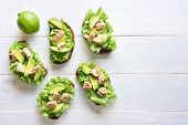 Healthy Tuna Sandwiches With Avocado And Lettuce Leaves Over Light Wooden Background With Copy Space poster