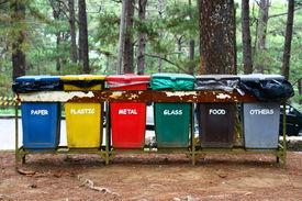 stock photo of segregation  - color coded trash bins for waste segregation - JPG