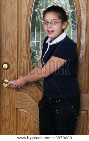 Preteen Checking The Door Lock