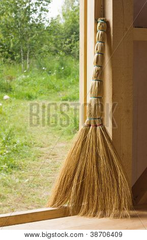 Besom In Doorway Of Wooden Country House