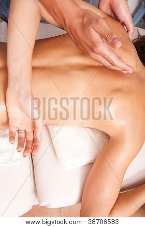 arms and upper back massage technique in spa salon