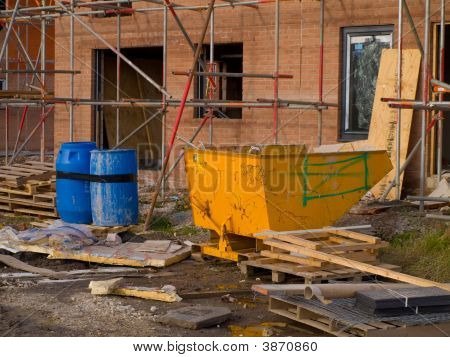 Construction Site With Scaffolding And New Build