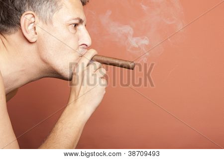 Man smoking a Cuban cigar