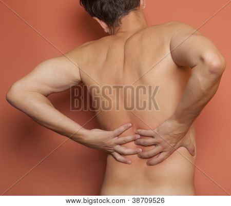 Adult man having pain in his back