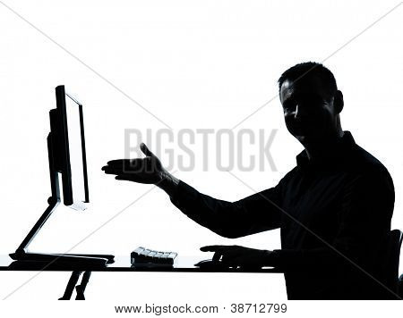 one caucasian business man showing gesture computer computing silhouette in studio isolated on white background