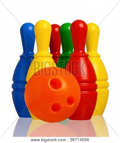 Colorful plastic skittles of toy bowling with orange ball isolated on a white background