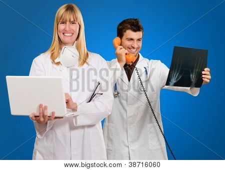 Male And Female Doctor's At Work On Blue Background