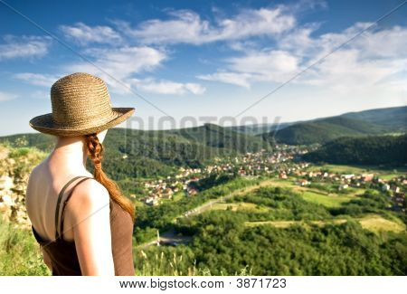 Woman In Hat Looking At View