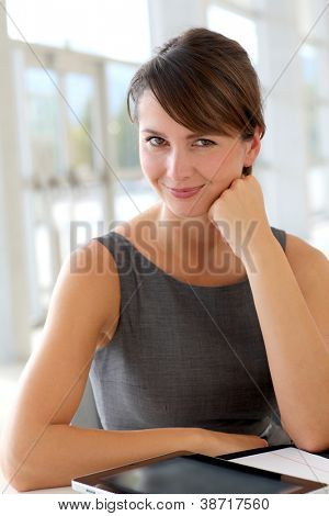 Portrait of charming businesswoman in office