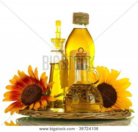 oil in jars and sunflowers, isolated on white