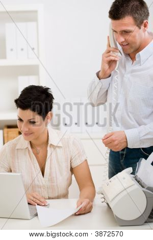 Couple Working At Home Office