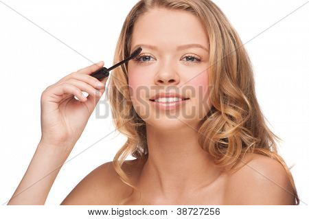 Beautiful woman applying mascara on her eyelashes, isolated on white background