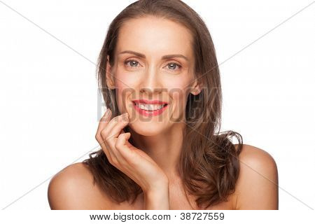Portrait of attractive groomed healthy middle-aged woman touching her face, isolated on white background