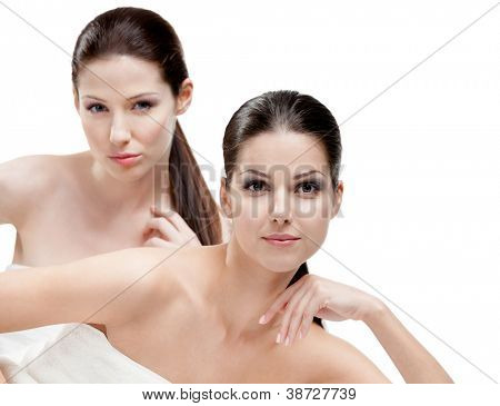 Half length portrait of two half naked women who are ready for beauty procedures, isolated