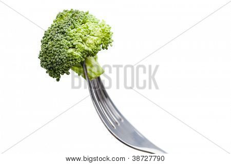 Close up of brocolli on the fork, isolated on white. Healthy dieting food
