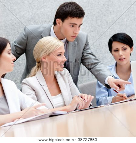 Business people discuss something at the meeting at the modern office building. Teamwork success