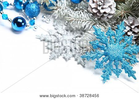 Christmas decoration with snowflake and frosty branch.