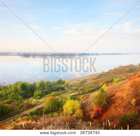 Autumn calm river Kama at sunrise. Russia