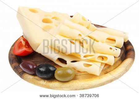 gold swiss cheese sliced on wooden platter with olives and tomato isolated over white background