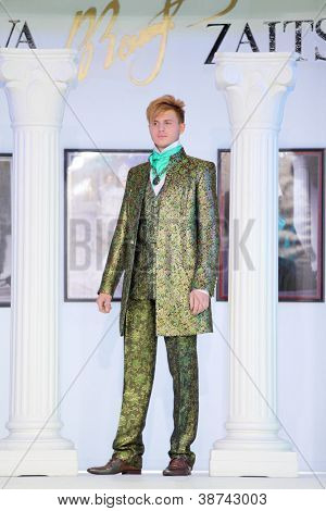 MOSCOW - NOVEMBER 4: Man in bright suit on show of designer Slava Zaitsev in fashion house of Slava Zaitsev on November 4, 2011 in Moscow, Russia.