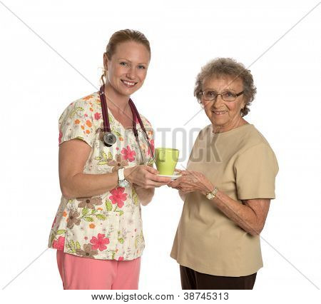 Friendly Nurse Helping Elderly Senior with Coffee Isolated on White Background