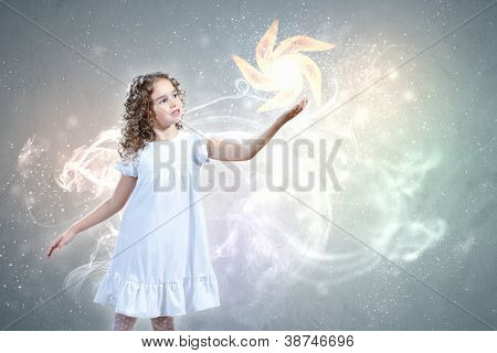 Little girl with magic lights and shining around
