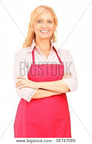 A female manual worker wearing an apron and posing against white background