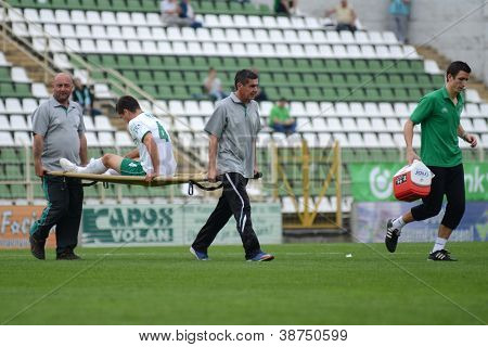 KAPOSVAR, HUNGARY - SEPTEMBER 29: Lukacs Bole (in white) injured at a Hungarian National Championship soccer game - Kaposvar (white) vs Eger (red) on September 29, 2012 in Kaposvar, Hungary.
