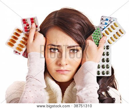 Young woman having pills and tablets. Isolated.